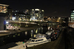 stock image of  regents canal near kings cross london at night.