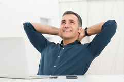 stock image of  relaxed man daydreaming