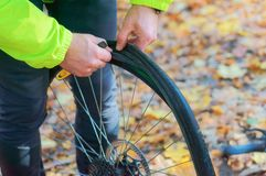 stock image of  repair the puncture of the bike