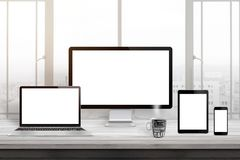 stock image of  responsive web site design mockup. computer displaz, laptop, tablet and smart phone on office desk