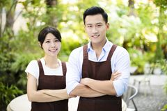 stock image of  restaurant owner standing with partner