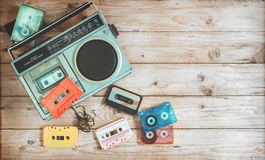 stock image of  retro technology of radio cassette recorder music with retro tape cassette on wood table
