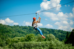 stock image of  riding on a zip line