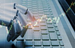 stock image of  robot business concept market analysis graph,robot hand pressing computer