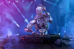 stock image of  robot disc jockey at the dj mixer and turntable plays nightclub during party. entertainment, party concept. 3d illustration