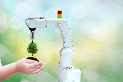 stock image of  robot tree environmental industrial tree in the arm future