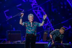 stock image of  russell hitchcock  from air supply, singing beautiful melody at epcot in walt disney world 14