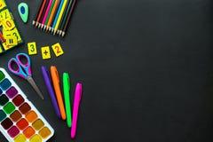 stock image of  school supplies mockup on blackboard background with copyspace.