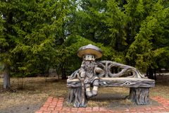 stock image of  sculpture of a storybook character from children`s fairy tales the old man treefolk. the fantastic sculpture in the natural park