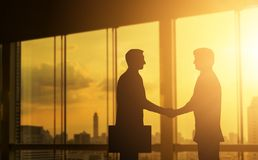 stock image of  second hand business hand in concept office silhouettes and successful business partner.