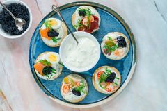 stock image of  selection of cocktail blinis - gourmet party food