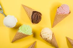 stock image of  selection of colorful ice cream scoops on yellow background