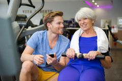 stock image of  senior woman doing sport exercises with coach or personal trainer