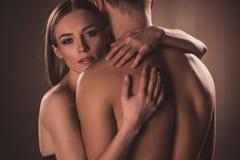 stock image of  sensual nude lovers hugging,
