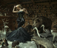 stock image of  sensual woman in a locked room full of wild animals