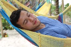 stock image of  serene man enjoying a hammock