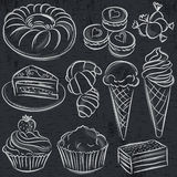 stock image of  set of different sweetmeats on blackboard