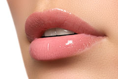 stock image of  womans lips. beauty lips make-up. beautiful make-up. sensual open mouth. lipstick and lip gloss. natural full lips