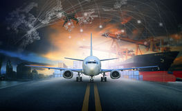 stock image of  ship loading container in import - export pier and air cargo plane approach in airport use for transport and freight logistic bus