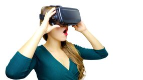stock image of  shocked woman using virtual reality device when holding it with hands over white background