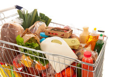 stock image of  shopping cart full dairy grocery