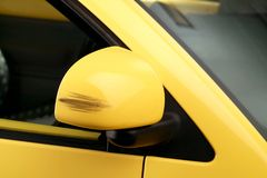 stock image of  side mirror with damage