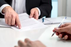 stock image of  signing a contract or agreement.