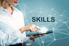 stock image of  skills text with business woman