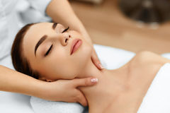 stock image of  skin, body care. woman getting beauty spa face massage. treatment.