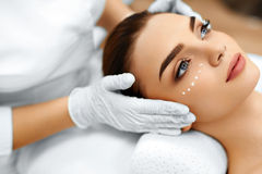 stock image of  skin care. cosmetic cream on womans face. beauty spa treatment