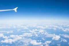 stock image of  sky and clouds seen from plane window. atmosphere, stratosphere, air. cloudscape, weather, nature. wanderlust, adventure, discover