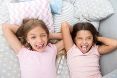 stock image of  slumber party timeless childhood tradition. girls relaxing on bed. slumber party concept. girls just want to have fun