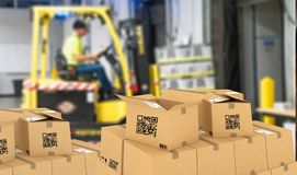 stock image of  smart logistic, industry 4.0, smart warehouse using qr codes to manage packages and inventory