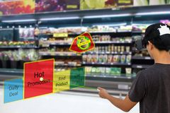 stock image of  smart retail with augmented and virtual reality technology concept, customer use ar and vr glasses to search a daily deal,hot pro