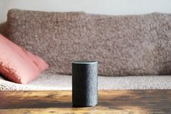 stock image of  smart speaker standing on coffee table