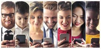 stock image of  smartphone addicts