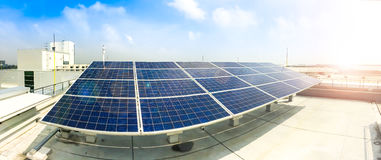 stock image of  soft focus of solar panels or solar cells on factory rooftop or terrace with sun light, industry in thailand, asia.