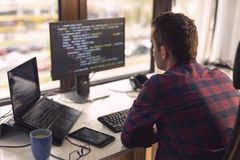 stock image of  software developer working