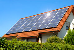 stock image of  solar panel on a red roof