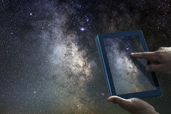 stock image of  space astronomy exploration concept. night sky tablet milky way