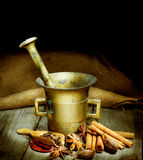 stock image of  spices and antique mortar