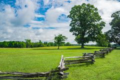 stock image of  split rail fence in a field on a beautiful spring day