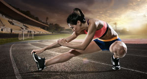 stock image of  sport. runner stretching on the running track.