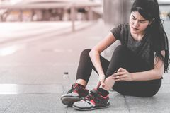 stock image of  sport woman having an injury on her ankle foot