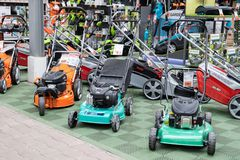 stock image of  st. petersburg, russia - march, 2019: lawn mowers for sale. many brands are recognizable