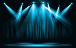 stock image of  stage lights. blue spotlight with certain through the darkness.