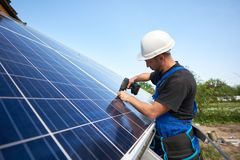 stock image of  stand-alone exterior solar panel system installation, renewable green energy generation concept.