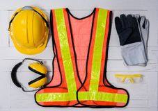 stock image of  standard construction safety equipment on wooden table. top view