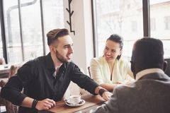 stock image of  startup diversity teamwork brainstorming meeting concept. business team coworkers sharing world economy report document