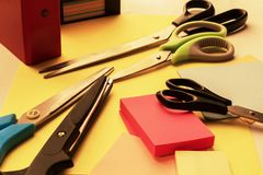 stock image of  stationery scissors for work, school and hobbies of different sizes, shapes  stickers on the desktop